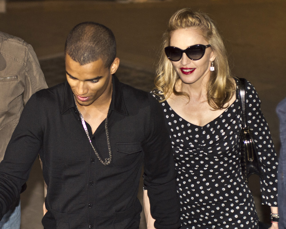 madonna and boy exit of the restaurant in rome